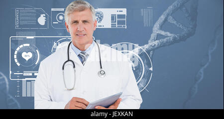 Doctor looking at camera and holding tablet - Stock Photo