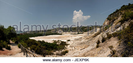 The crater of the dormant volcano of Solfatara emits jets of steam with sulfurous fumes. - Stock Photo
