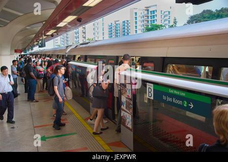 SINGAPORE - JAN 13, 2017: Passengers in Singapore Mass Rapid Transit (MRT) train. The MRT has 102 stations and is - Stock Photo