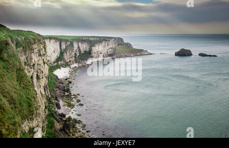 Near the tiny island of Carrickarede (from Irish: Carraig a' Ráid, meaning 'rock of the casting') in County Antrim - Stock Photo