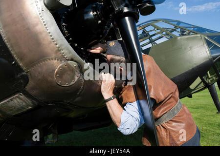 RAF groundcrewman attends to the Bristol Mercury engine on a Blenheim Mk1 reenactment Ops3945 - Stock Photo