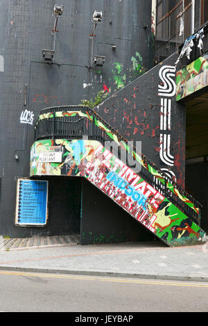 Poster covered old outdoor stairway leading to club on Mount Pleasant Street,Liverpool - Stock Photo