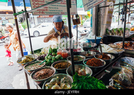 Bangkok, Thailand - September 11, 2016: Vendor sells food on the street on September 11, 2016 in Bangkok, Thailand - Stock Photo