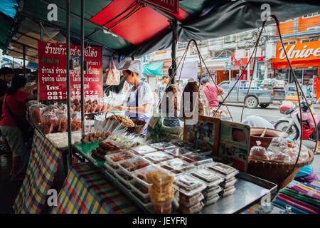 Bangkok, Thailand - September 11, 2016: Vendors sell food on the street on September 11, 2016 in Bangkok, Thailand - Stock Photo