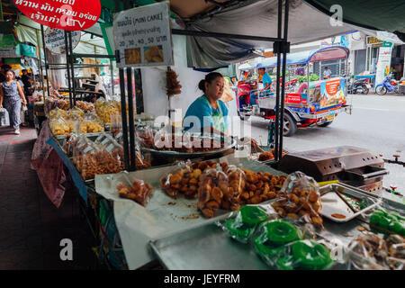 Bangkok, Thailand - September 11, 2016: Vendor cooking food on the street on September 11, 2016 in Bangkok, Thailand - Stock Photo