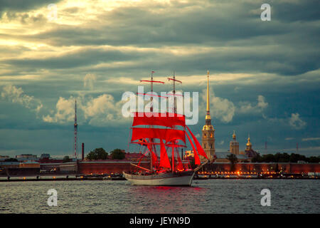 Brig with scarlet sails on the river Neva. Rehearsal of holiday for school graduates 'Scarlet Sails'. ST PETERSBURG, - Stock Photo