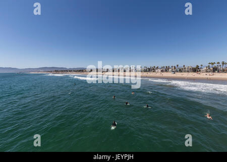 Los Angeles, California, USA - June 26, 2017:  Surfers waiting for waves at Venice Beach. - Stock Photo