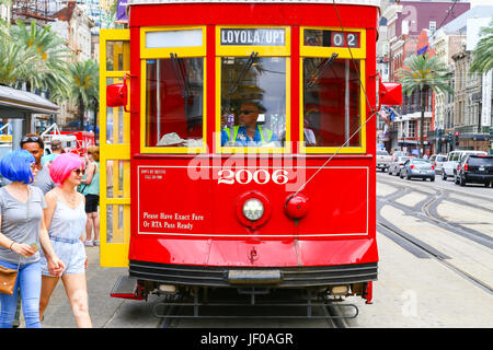 Streetcar Stopping on Canal Street - Stock Photo