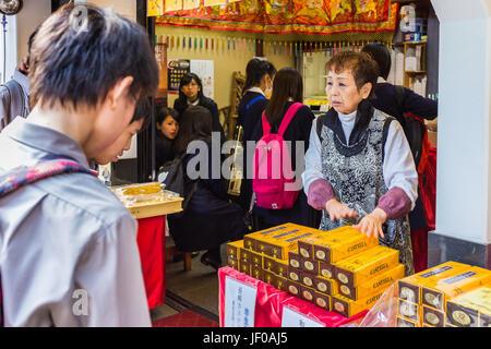 Japanese shopkeeper in Nagasaki Chinatown,Japan