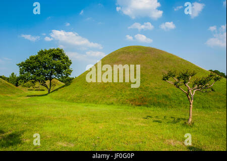 Tumuli park with its tombs from the Shilla monarchs in the Unesco world heritage sight Gyeongju, South Korea - Stock Photo