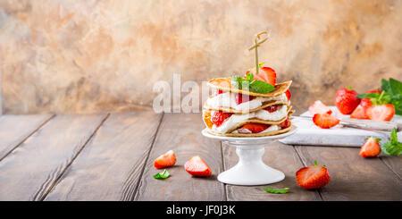 Pancakes cake with yogurt and strawberries - Stock Photo