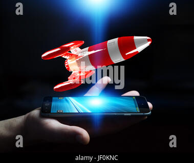 Businessman on blurred background holding red rocket in his hand 3D rendering - Stock Photo