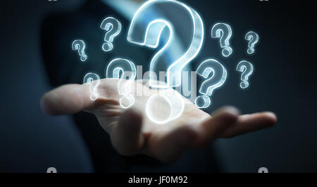Businessman on blurred background holding hand drawn question marks - Stock Photo
