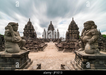 View of the Hindu Temple of Candi Sewu and two large guardian statues at the Prambanan Temple complex, Indonesia. - Stock Photo
