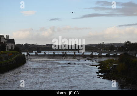 River Corrib and Dam near a Cathedral in Galway, Ireland - Stock Photo