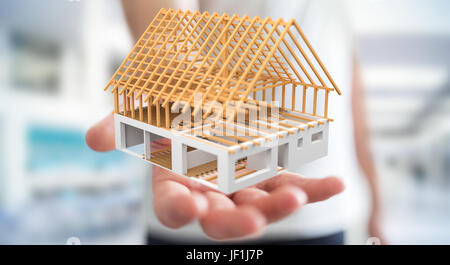 Businessman on blurred background holding 3D rendering unfinished plan house in his hand - Stock Photo