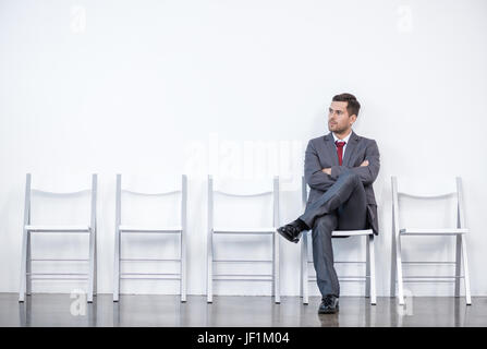 businessman sitting and waiting for interview in office, business concept - Stock Photo