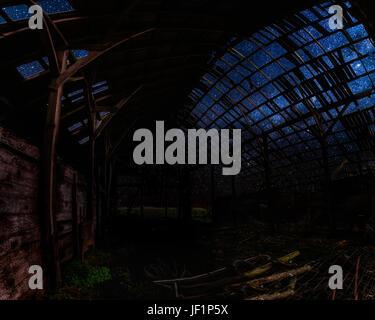 Looking Through an Abandoned Barn at Night - Stock Photo