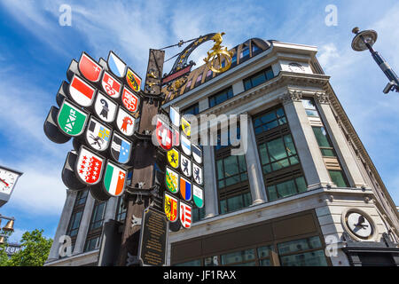 Cantonal Tree displaying the coats of arms of 26 cantons of Switzerland, Leicester Square, London, UK - Stock Photo