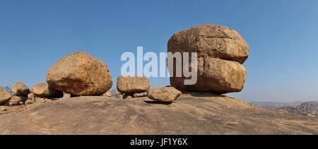 Big round granite boulder in Hampi, India - Stock Photo