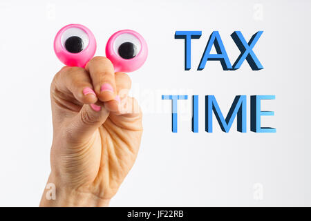 Funny character creature looking surprised and and trying to intimidate the viewer with words Tax Time. Depicted - Stock Photo