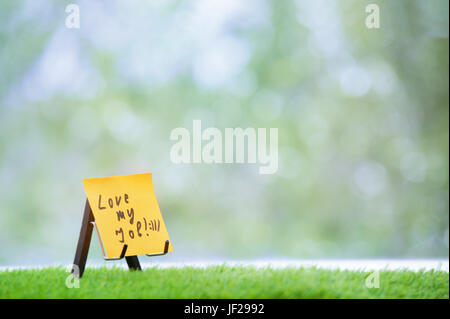 Adhesive note with Love my job text - Stock Photo