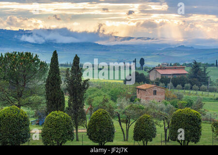 Landscape view with sunset over Tuscany in Italy from a garden - Stock Photo