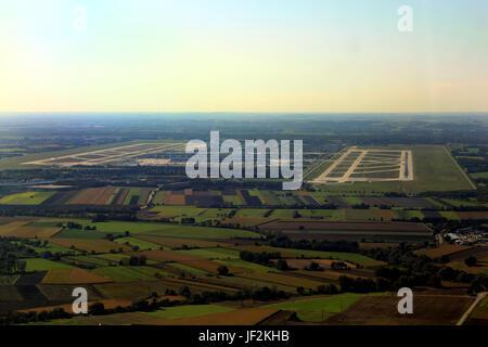 Approaching runway 26R at Munich airport - Stock Photo
