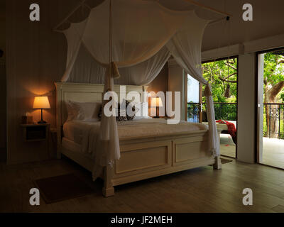 The master bedroom in the Billy Mitchell Suite at Firefly Hotel, Mustique - Stock Photo
