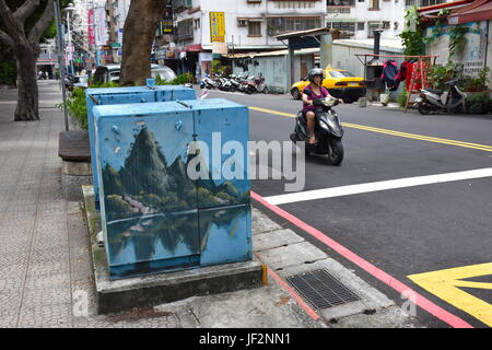 Taiwan electric company paints the power boxes along the street with different scenes on every box, from mountains - Stock Photo