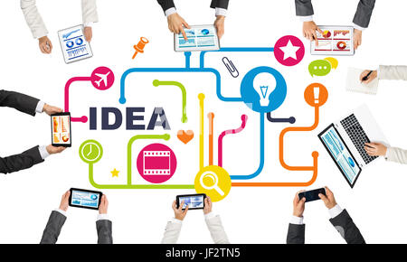 Group of people with devices in hands working together as symbol of networking and communication - Stock Photo