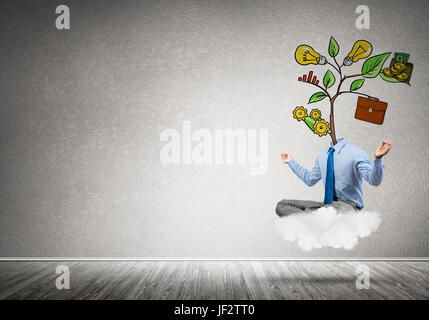 Businessman in lotus pose with lamp head meditating on cloud - Stock Photo