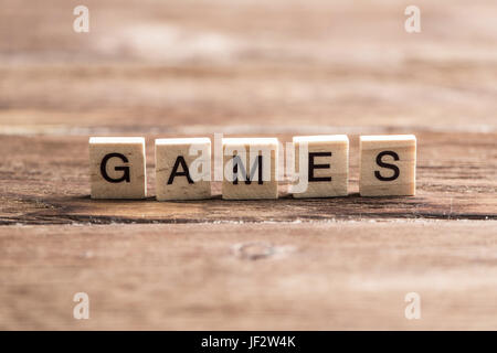 Alphabet wooden letters on wood collected to word games - Stock Photo