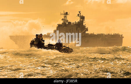 050627-N-9866B-012  A U.S. Marine Corps amphibious assault vehicle travels through the Pacific Ocean after departing - Stock Photo