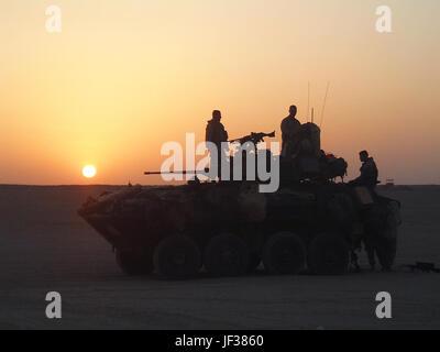 050526-M-1195M-002   U.S. Marines prepare their Light Armored Vehicle for a night movement to Udairi Range near - Stock Photo