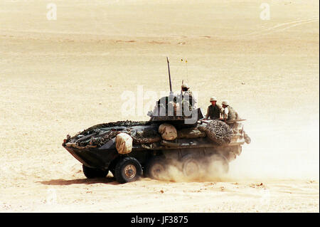 000408-D-9880W-156 A U.S. Marine Corps Light Armored Vehicle (LAV-25) maneuvers off the range at the conclusion of a live-fire training exercise at the Udairi Training Range in northern Kuwait on April 8, 2000.  The LAV-25 is an all-terrain, all-weather vehicle with night capabilities and is armed with a turret-mounted 25 mm chain gun, and a 7.62 mm machine gun.  The vehicle is capable of transporting six Marines inside the hull.  The LAV is attached to the 1st Light Armored Reconnaissance Battalion, 15th Marine Expeditionary Unit.  DoD photo by R. D. Ward.  (Released) Stock Photo