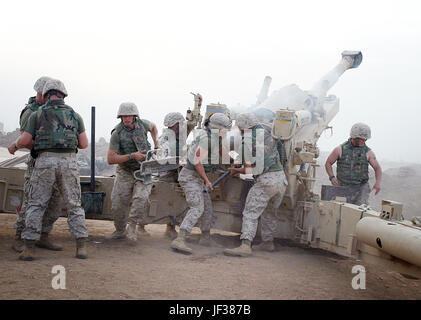 041021-M-8096K-036 U.S. Marines fire an M198 Medium Howitzer providing supporting and defensive fire for Camp Fallujah - Stock Photo