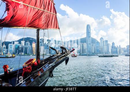 Aqualuna bow sail foreground, Hong Kong skyline background - Stock Photo