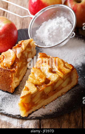 Sliced homemade warm apple pie close-up on a table. vertical - Stock Photo