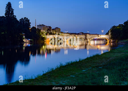 Turin Bridge Umberto I and river Po at twilight - Stock Photo