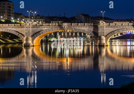 Turin Bridge Umberto I at twilight - Stock Photo