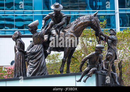 The Petrie Tableau, sculpture group created in 1988 to acknowledge pioneer families of Brisbane, in front of City - Stock Photo