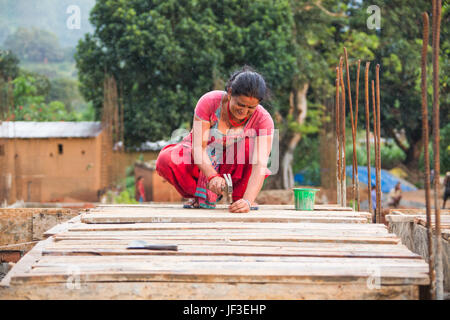 Woman builder, Nuwakot district of Nepal - Stock Photo