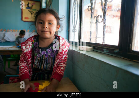 A maya indigenous girl at preschool in El Barranco, Solola, Guatemala. - Stock Photo
