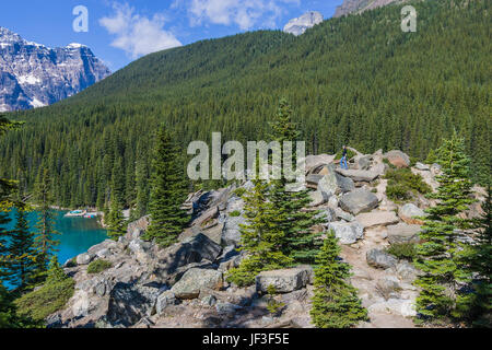 Hiker at Moraine Lake in Banff National Park, Alberta, Canada. Moraine Lake is a glacially-fed lake in Banff National - Stock Photo