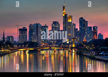 Frankfurt skyscrapers reflected on Main River at twilight, Germany - Stock Photo