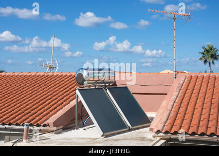 Solar panels and hot water cylinder on roof of apartment building, Rethymno (Rethymnon), Rethymno Region, Kriti - Stock Photo