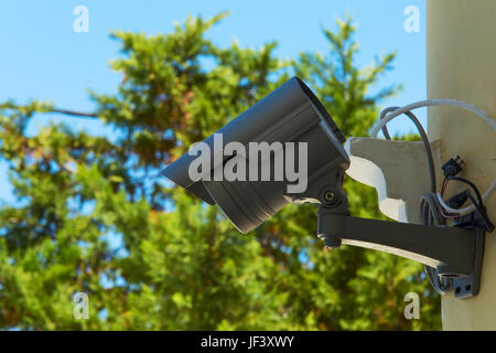 CCTV camera mounted on a building wall - Stock Photo