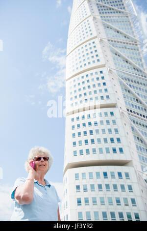 Senior woman talking through phone - Stock Photo