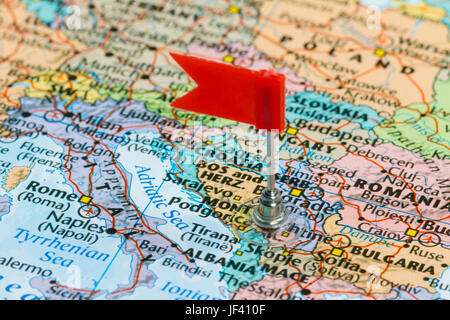 Photo of Montenegro marked by red flag in holder. Country on European continent. - Stock Photo